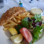 Fish and chips with fresh salad