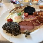 Pictures show  A awesome chess set, complimentary dram, breakfast area, fruit breakfast and full