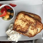 Cinnamon French Toast (custard-soaked challah with vanilla whipped cream + pure maple syrup)