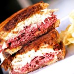 Grilled Boar`s Head Corned Beef piled high with Melted Swiss Cheese, Sauerkraut and Ginger Washa