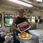 The Island Chef displaying the fresh Ahi and delicious coconut shrimp platter.