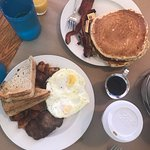 Pancakes with bacon, sausage patties and eggs breakfast special - SO GOOD!