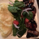 Pork tenderloin medallions with a side of spinach and mashed potatoes