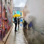 Walking down an alley filled with art ...and smoke.