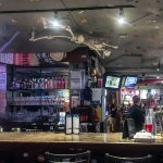 Bar with Skeleton Climbing Rock Wall on Ceiling