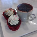 Caramel and Red Velvet cupcakes with cappuccino