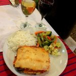 Moussaka with a portion of sauted veggies and steamed rice along with Res & White Wine