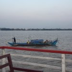 Pictures about weaving silk and a boat on the Mekong.
