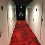 "The hallway to the room. ""Welcome to spaceport X."""