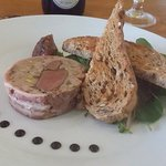 Pigeon and pork terrine wrapped in bacon