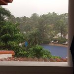View from balcony overlooking pool - rainy