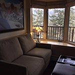Love seat and window view.
