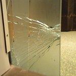 Broken glass wall in bathroom