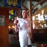 Bartender in costume as Flo from Progressive Ins.