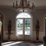 Stunning chandelier and doors to the outside