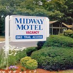 The Midway's sign and plantings greet guests as they arrive at the property