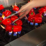 Chef Tommy flame-roasting red peppers.