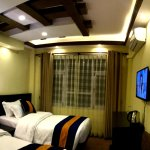 Deluxe room with comfortable bed, city view, good decoration, free WiFi and many more.