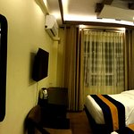 Clean, attractive, comfortable  bed in hotel Norbulinka. It is a Twins Deluxe room of this hotel
