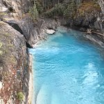An azure blue pool of glacial water