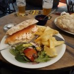 Smoked salmon with prawns in brown bread, chips and salad