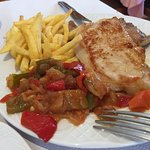 Pork dish with fries and ratatouille