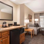 Your stay at the Northwest Arkansas Embassy Suites includes a beautifully decorated two-room sui