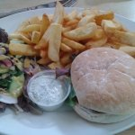 Lamb burger served with mint sauce.