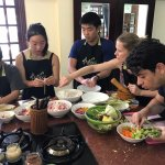 Everyone super-engaged at the cooking studio. These are challenging dishes--you will earn your k