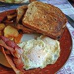 Eggs, home fries, bacon, cinnamon raisin toast