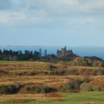 Glengorm Castle, with islands of Colonsay and Tiree beyond
