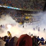 Fog envelops Boise State's players as they enter the field.