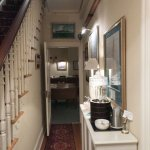 Entrance hallway leading to dining room and stairway to bedrooms.s