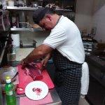 Vassos preparing a nice piece of steak to satisfy the most discerning customer