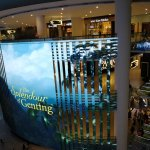 The big screen displaying the spelndour of Genting and its activities.