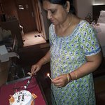 Birthday lady about to offer a slice to hubby