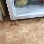 Grubby floor exposed and left uncleaned when broken fridge was replaced