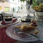 Remnants of tasty blackberry pie and a carafe of coffee