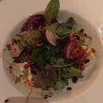 An artichoke salad with cheese and radish for starters