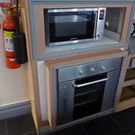 Our shared kitchen has microwave and oven, as well as three stovetops