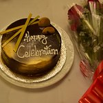 Anniversary cake and Flower bouquet..