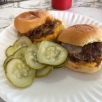 Cheeseburgers with onions and pickles