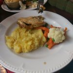Rock solid mash potato, dried pie, and a pathetic assortment of defrosted veg