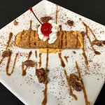 Pumpkin Cheesecake Cannoli with Pumpkin-Spice Caramel Sauce and Candied Pecans