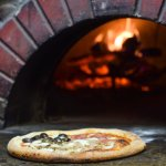 Our 800 degree wood-fired, Italian-made pizza oven