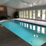 Inn's enclosed swimming pool with fireplace & view.