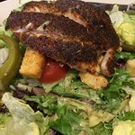 Friendly service, try the blackened grouper salad