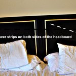 Easily accessible power strips on either side of the headboard for medical equipment and compute