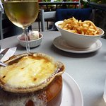 My meal of French Onion Soup, fries and a glass of white wine