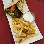 Kofte in Pita, cacik sauce, and fries.         $8.95